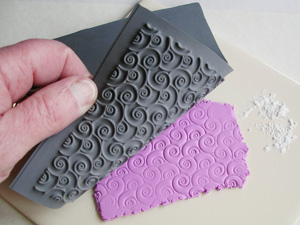 Using a Lisa Pavelka texture stamp Decorative, Swirly Q