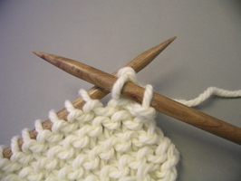 A new row with 2 stitches. Casting off a stitich