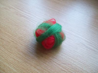 Red and Green Dyed Merino Wool Wisps around Cling Film