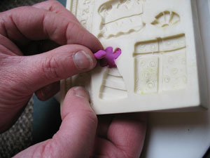 Pushing Polymer Clay into Mould