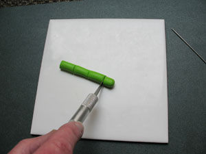 Using a craft knife to cut polymer clay