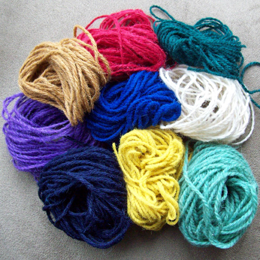 Different coloured rug yarns