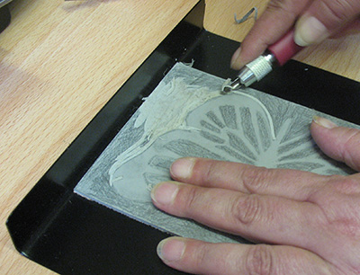 Holding the Lino Block in place