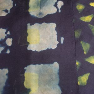 Black dye on silk fabric is removed with discharge paste