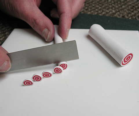 Slicing a polymer clay cane