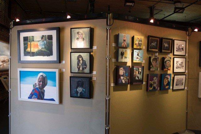 Artists work at the Yvonne Arnaud Art Exhibition