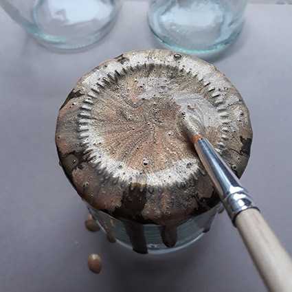 Brush the Pearl Ex solution to the sides of the glass jar