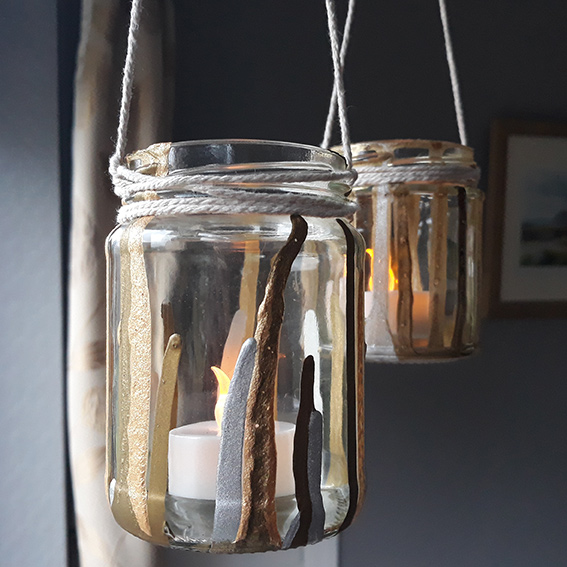 Hanging glass jars with tealights