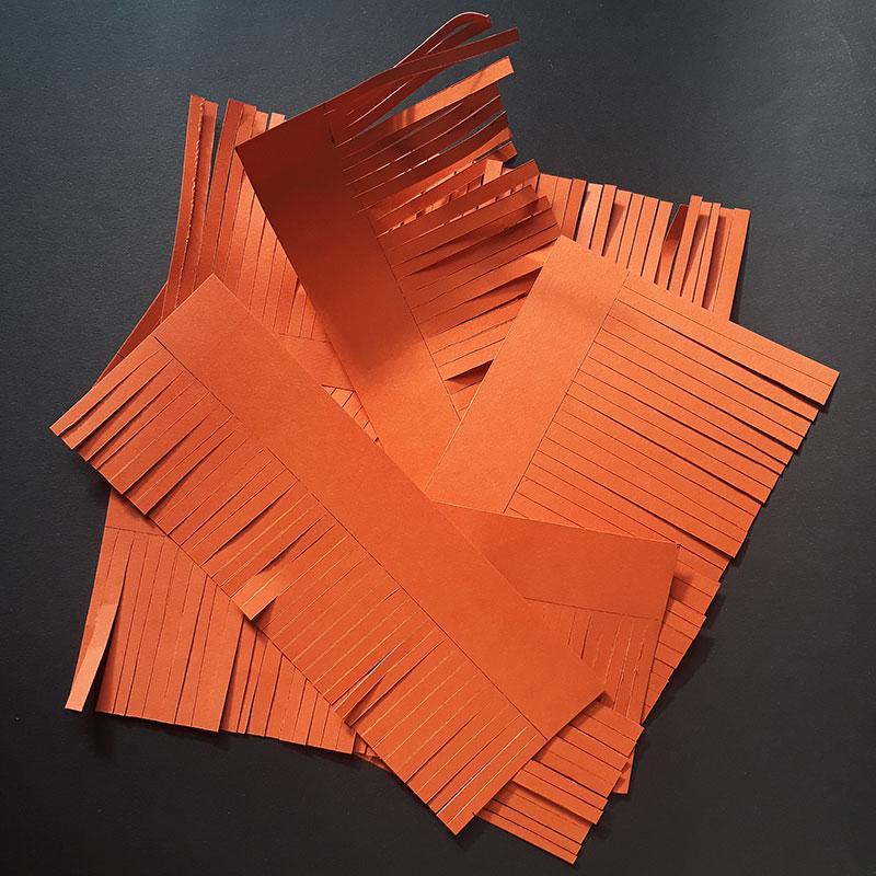 Cut the paper in strips