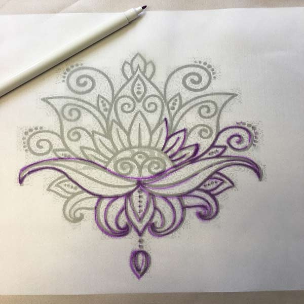 Using the auto fade pen to draw out the design on silk fabric