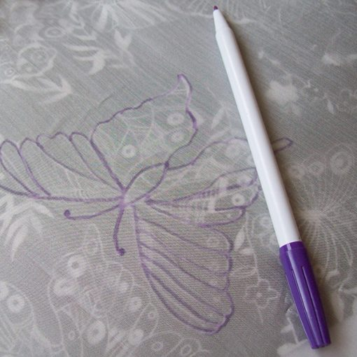 Use the autofade pen to trace images onto silk