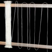 Polyester heddles on loom